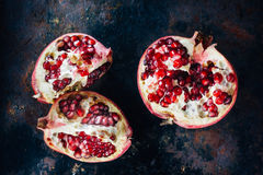 Top view of pomegranate fruit quarters and halves. Top view of pomegranate fruit quarters and halves stock image
