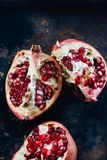 Top view of pomegranate fruit quarters and halves. Top view of pomegranate fruit quarters and halves royalty free stock images