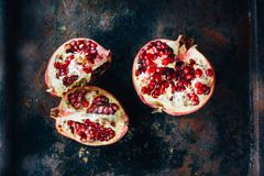 Top view of pomegranate fruit quarters and halves. Top view of pomegranate fruit quarters and halves royalty free stock photos