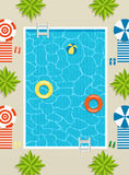 Top view of pool with sun loungers and umbrellas. Palm trees and inflatable circles in the water Royalty Free Stock Photography