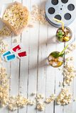 Top view of popcorn with iced tea film reels and 3D glasses on table Movie time concept royalty free stock photography