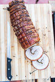 Top view of a Porchetta on a wooden cutting board royalty free stock photo