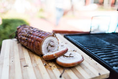 Top view of a Porchetta on a wooden cutting board Royalty Free Stock Photography