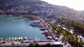 Top view of port with sea vessels at resort mountain town. Clip. Beautiful seaport with yachts and ships in background. Of city in highlands. Port ships are stock footage