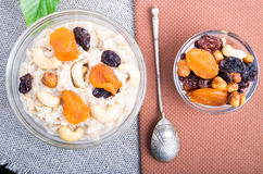 Top view of a portion of oatmeal with fruit and berries Royalty Free Stock Images