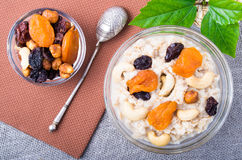 Top view of a portion of oatmeal with fruit, cashew nuts and ber Stock Image