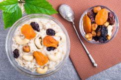 Top view of a portion of oatmeal with fruit, cashew nuts and ber Royalty Free Stock Photography