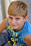 Top view portrait of a blond boy looking at camera Stock Photos