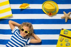 Top view portrait of child on striped beach towel stock image