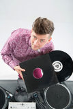 Top view portrait of dj showing his vinyl records Stock Photos