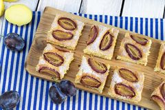 Top view on a Potato bubble cake with plum slices stock image
