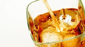 Top of view of  pouring whiskey on white background, whisky relax time stock video footage