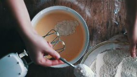 Top view of pours a glass of cream in the dough stock video