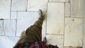 Top view POV of man in sneakers walking historical ancient sidewalk stock footage