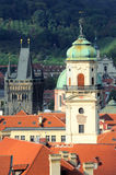 Top view on Powder Gate and a bell tower, Prague. Powder Gate, a church tower and rooftops. Top view from the Old City Hall tower in Prague royalty free stock photos
