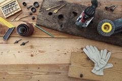 Top view of power tools for woodworking on wooden boards Royalty Free Stock Photos