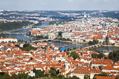 Top view of Prague, red roofs of the houses, the bridges over Vltava Stock Image