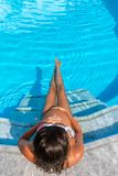 Top view of a pregnant woman sitting at the pool Royalty Free Stock Images