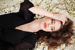 Top view of pretty sensual young woman in black dress Stock Photos
