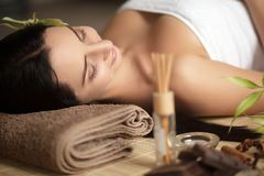 Top view of pretty woman laying in spa salon with closed eyes and relaxed Stock Images