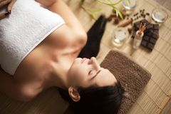 Top view of pretty woman laying in spa salon with closed eyes and relaxed Stock Photo