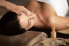 Top view of pretty woman laying in spa salon with closed eyes and relaxed Royalty Free Stock Image