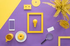 Yellow frame on violet background Stock Photos