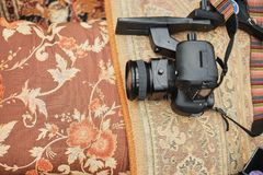 Top view, professional camera. Objects on the light carpet floor stock photo