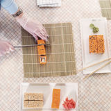 Top view of professional chef making and serving California sushi rolls in kitchen Royalty Free Stock Photos