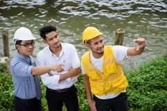 Top view of professional engineer team. Top view of happy professional engineering team look at construction site near the river. Concept for teamwork fo heavy stock photo