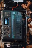 Top view of professional soundboard including audio mixer control panel with buttons and sliders, cords and microphone. Top view of professional soundboard royalty free stock photos