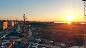 Top view of a property building site during sunset. Top view of a property building site during sundown. 4K stock video footage