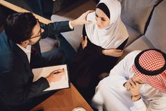 Top view. A psychotherapist encourage Arab woman. royalty free stock photography