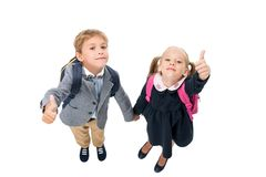 Pupils showing thumbs up. Top view of pupils showing thumbs up isolated on white Stock Photography