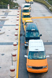 Top view on queue of taxicabs. Waiting on asphalt lane stand Royalty Free Stock Images