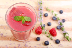 Top view of raspberry and blueberry juice Royalty Free Stock Images