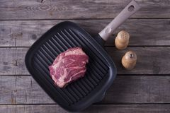 Top view of raw beef steak on grill pan. Receipt concept.  Royalty Free Stock Photos