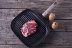 Top view of raw beef steak on grill pan. Receipt concept.  Royalty Free Stock Images