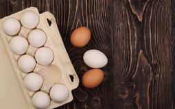 Chicken eggs on an old table Stock Photo