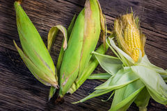 Top view raw corn On old wooden table. Stock Photo