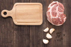 Top view raw fresh meat, garlic, pepper and cutting board on woo Stock Photos