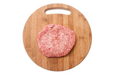 Top view of raw hamburger on wooden board prepared for roasting Royalty Free Stock Photography