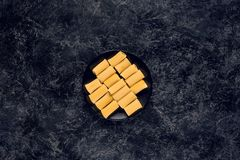 Top view of raw pasta. In black bowl stock photo