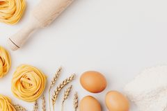 Raw pasta and ingredients Stock Photo