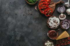 Top view of raw pizza ingredients. On concrete table Royalty Free Stock Images