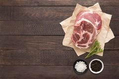 Top view raw pork chop steak and garlic, pepper on wooden backgr. Ound Stock Image