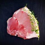 Top view raw pork chop steak t-bones on stone background Stock Photo