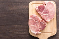 Top view raw pork chop steak  on wooden background.  Stock Photo