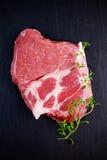 Top view raw pork rib eye steak on stone background.  Stock Image