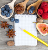 Top view of recipe book with ingredients Stock Image
